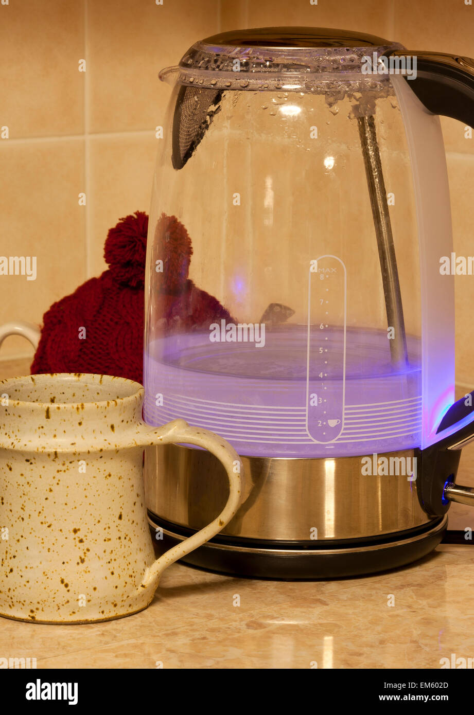 A jug kettle boiling water to make a hot drink - Stock Image