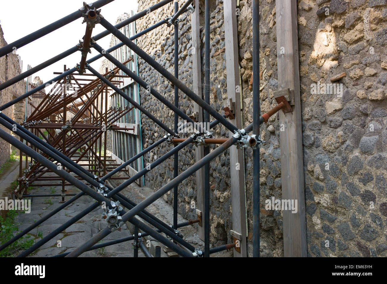 Scaffolding and props supporting building walls at the archaeological excavations of Roman Pompeii near Naples, - Stock Image