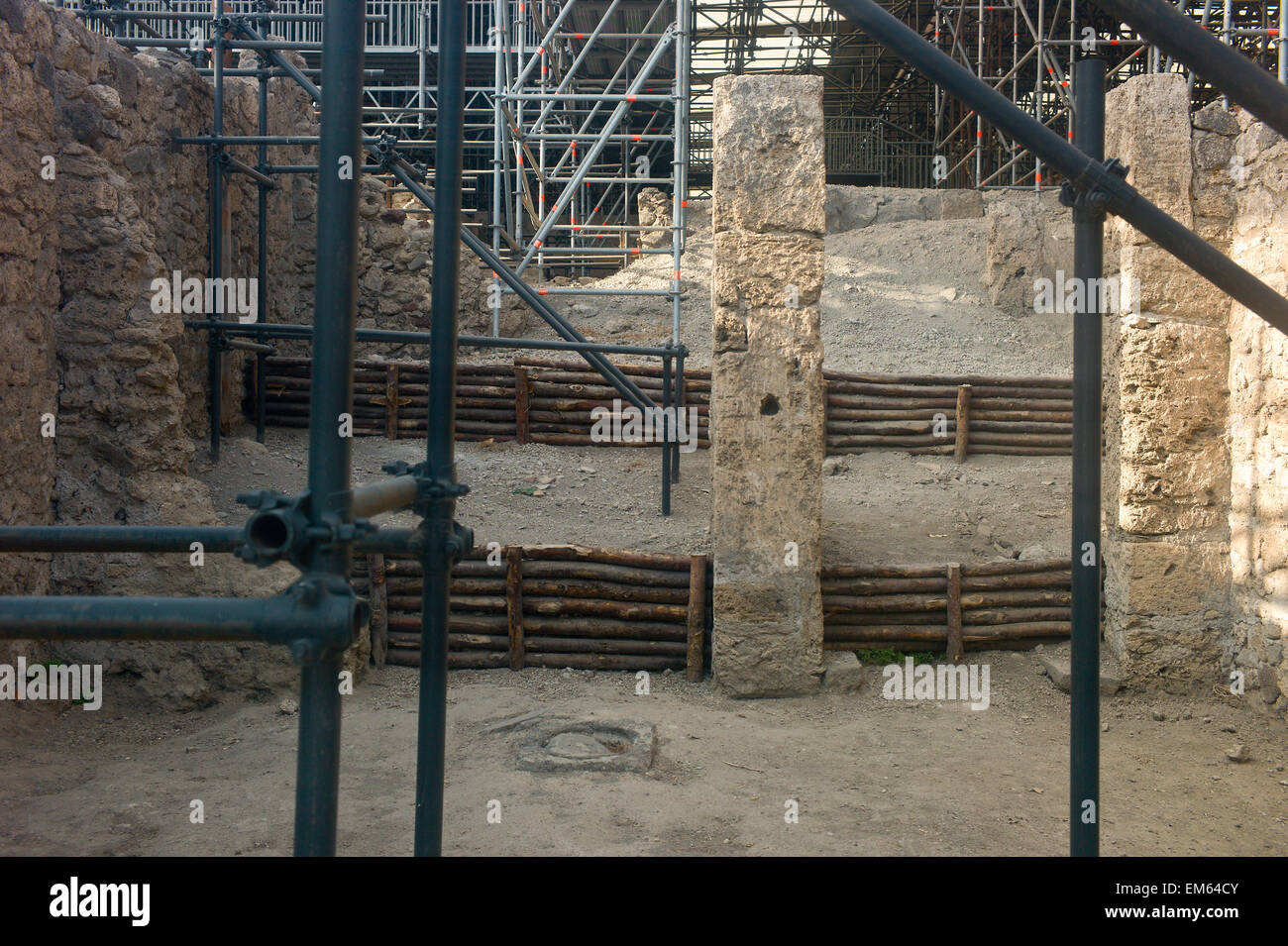Pompeii, Italy. Scaffolding and props supporting buildings waiting to be excavated or restored - Stock Image