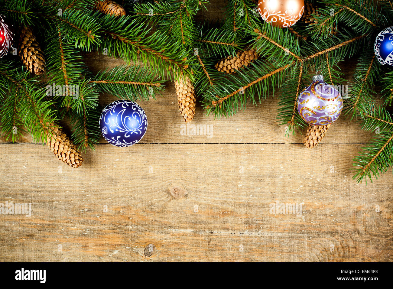 christmas fir tree with pinecones and decorations - Stock Image