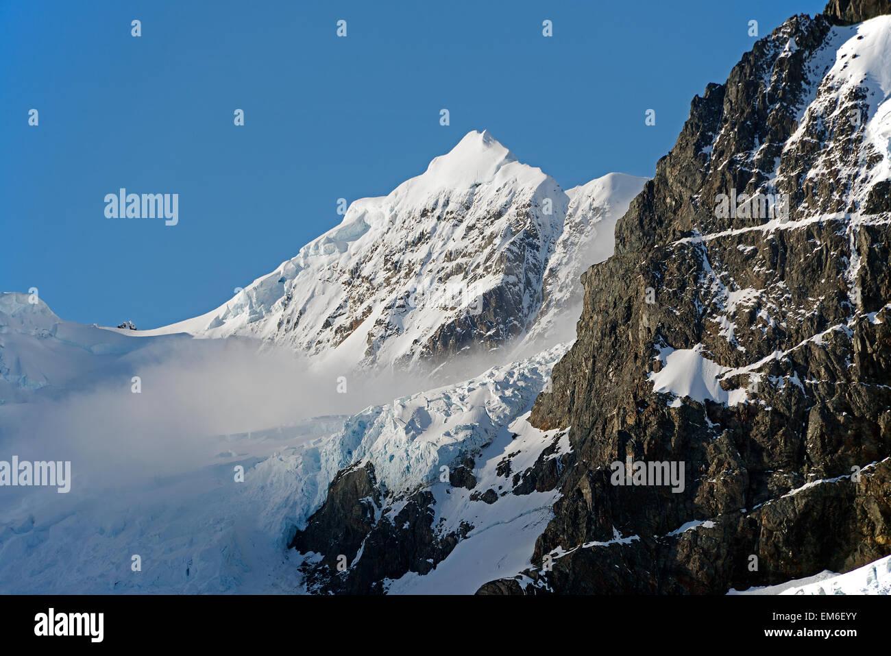 Snowcapped mountain Drygalski Fjord South Georgia - Stock Image