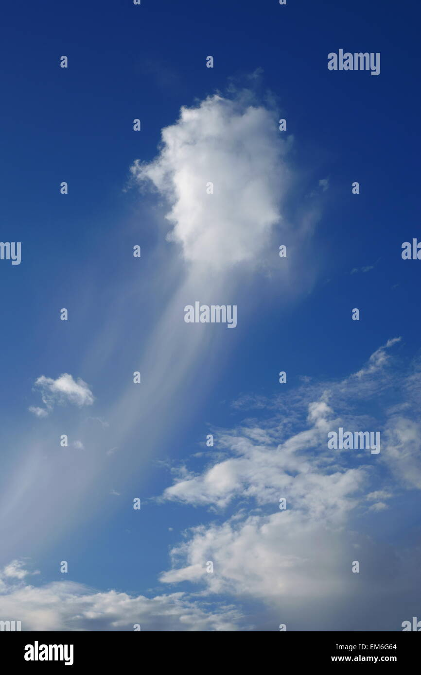 strange wispy cloud floating in the sky Stock Photo