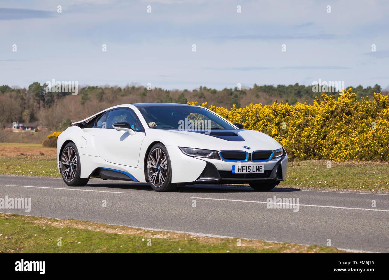 A White Bmw I8 Hybrid Electric Sports Car Drives Through The New