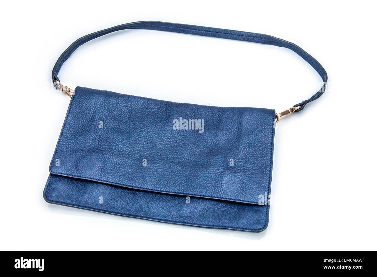 Navy blue leather Boden clutch bag isolated on a white studio background. - Stock Image