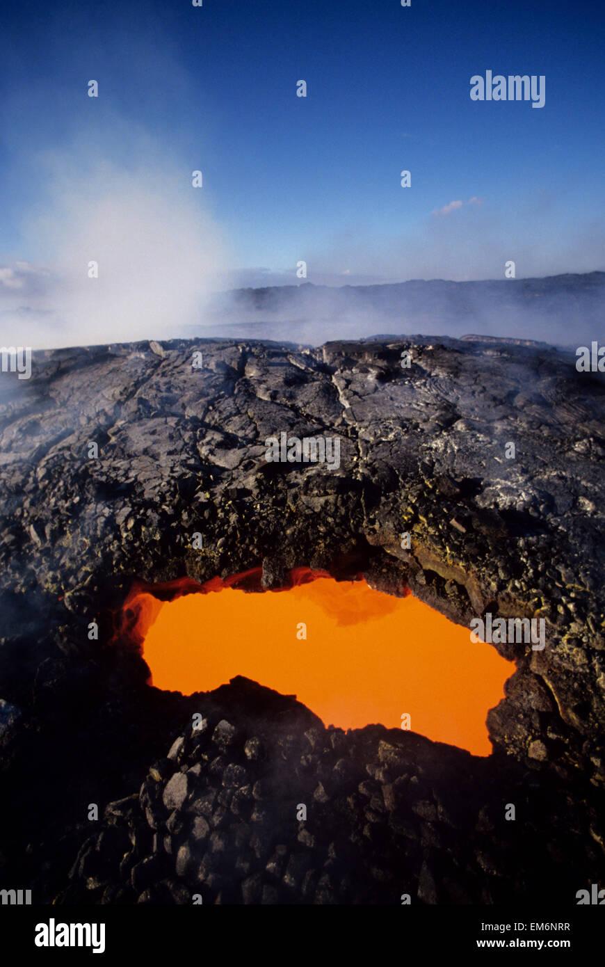 USA, Hawaii, Hawaii Volcanoes National Park; Big Island, East Rift Zone, Opening To Active Lava Tube Showing Orange - Stock Image