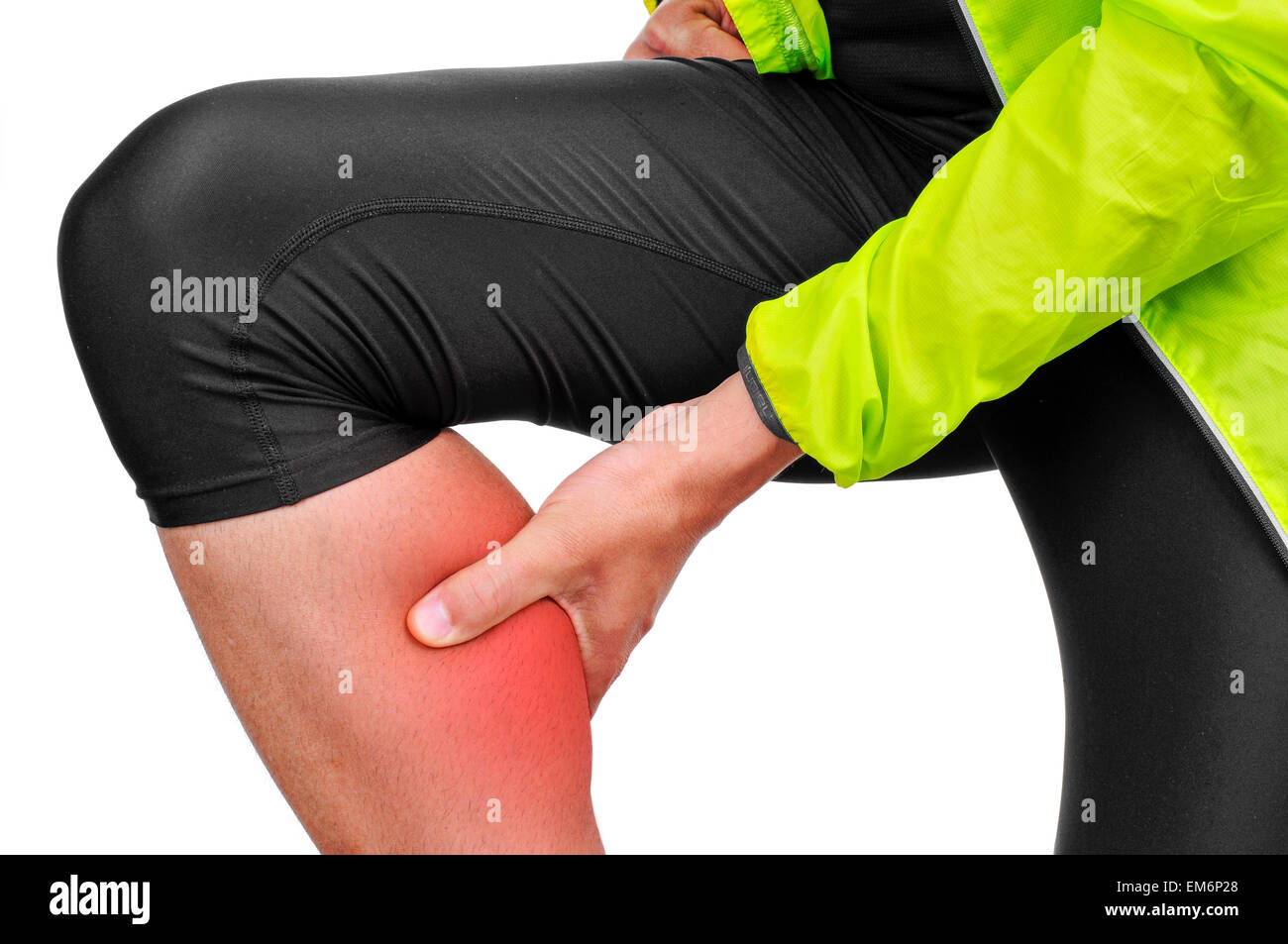 closeup of a young caucasian sportsman wearing sport clothes with his hand in his calf because of his calf muscle - Stock Image