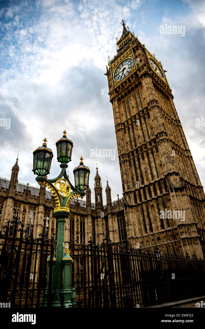 Big Ben and the golden and green lamp post. London is truly magical city in England. Its timeless architecture stands - Stock Image