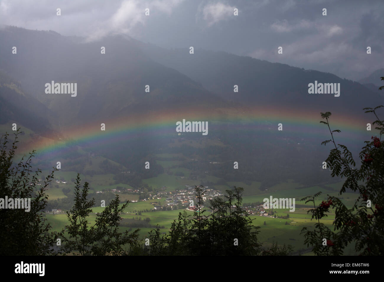 Rainbow and storm The valley of The River Salzach between Kaprun and Zell am See Pinzgau Salzbergerland Austria Stock Photo