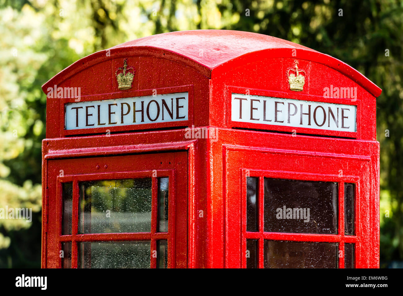 The red telephone box, a telephone kiosk for a public telephone, was a familiar sight on the streets of the United - Stock Image