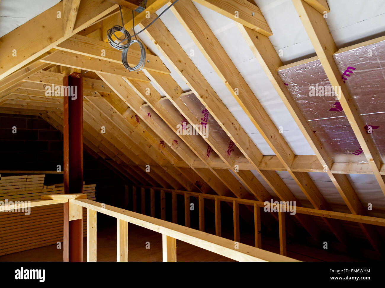 Interior Of New Building Under Construction Showing Insulation Panels  Timber Roof Joists And Wood Used In An Attic Space