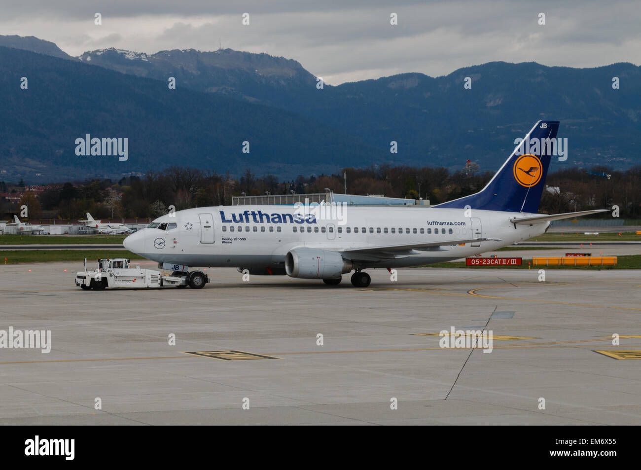 A Lufthansa Boeing 737 being towed along a taxiway  at Geneva airport. - Stock Image