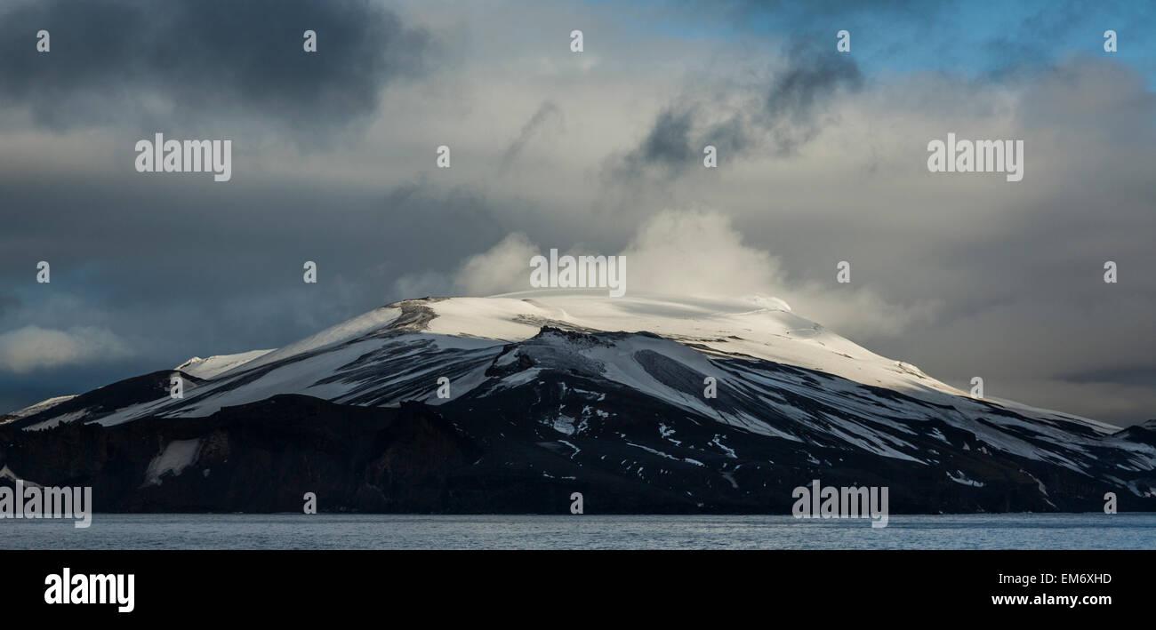 view of snow-capped peak of Deception Island, Antarctica - Stock Image