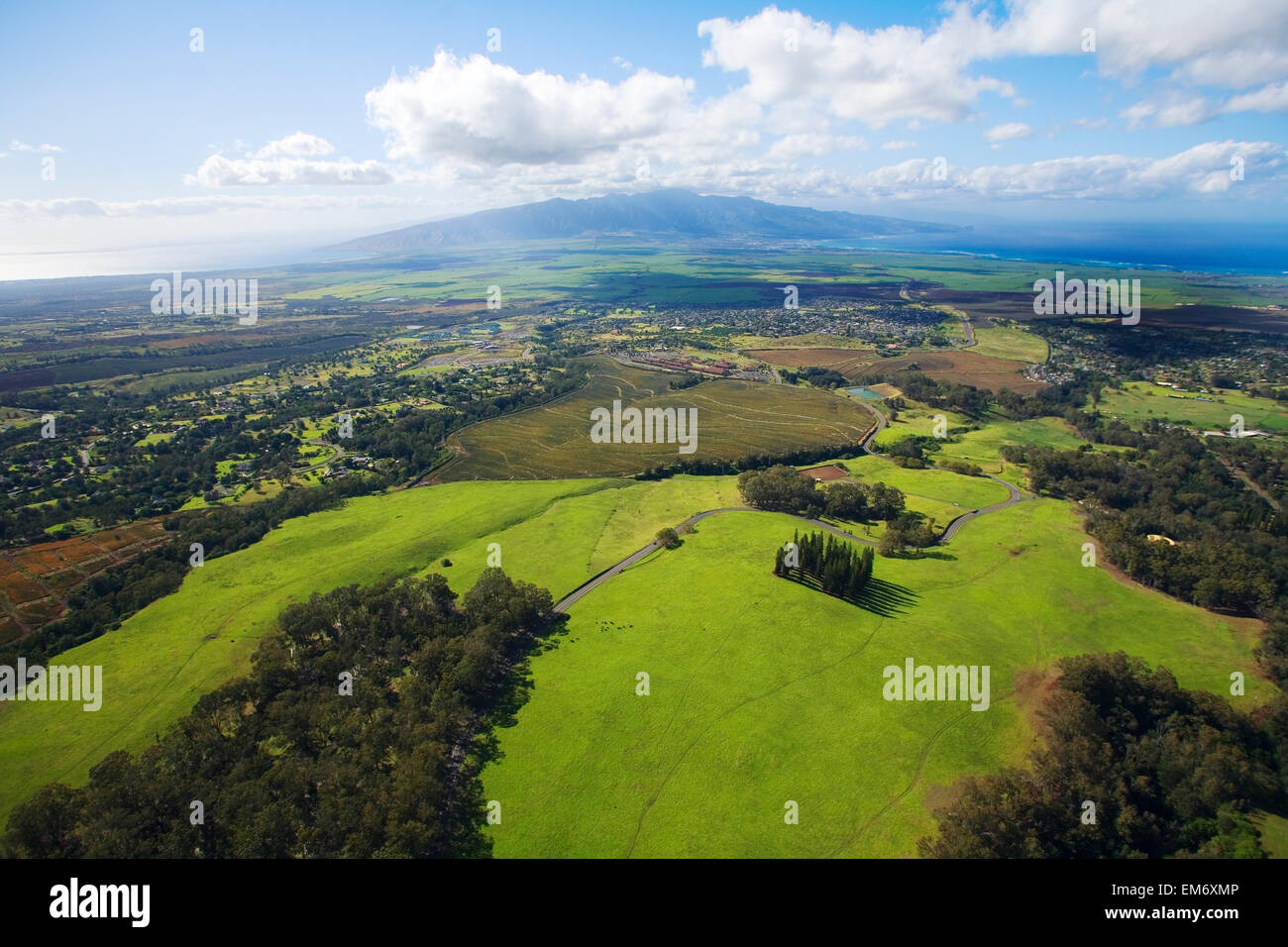 Hawaii. USA, aerial view; Maui, Scenic landscape of meadows of Haleakala Ranch and West Maui Mountains - Stock Image