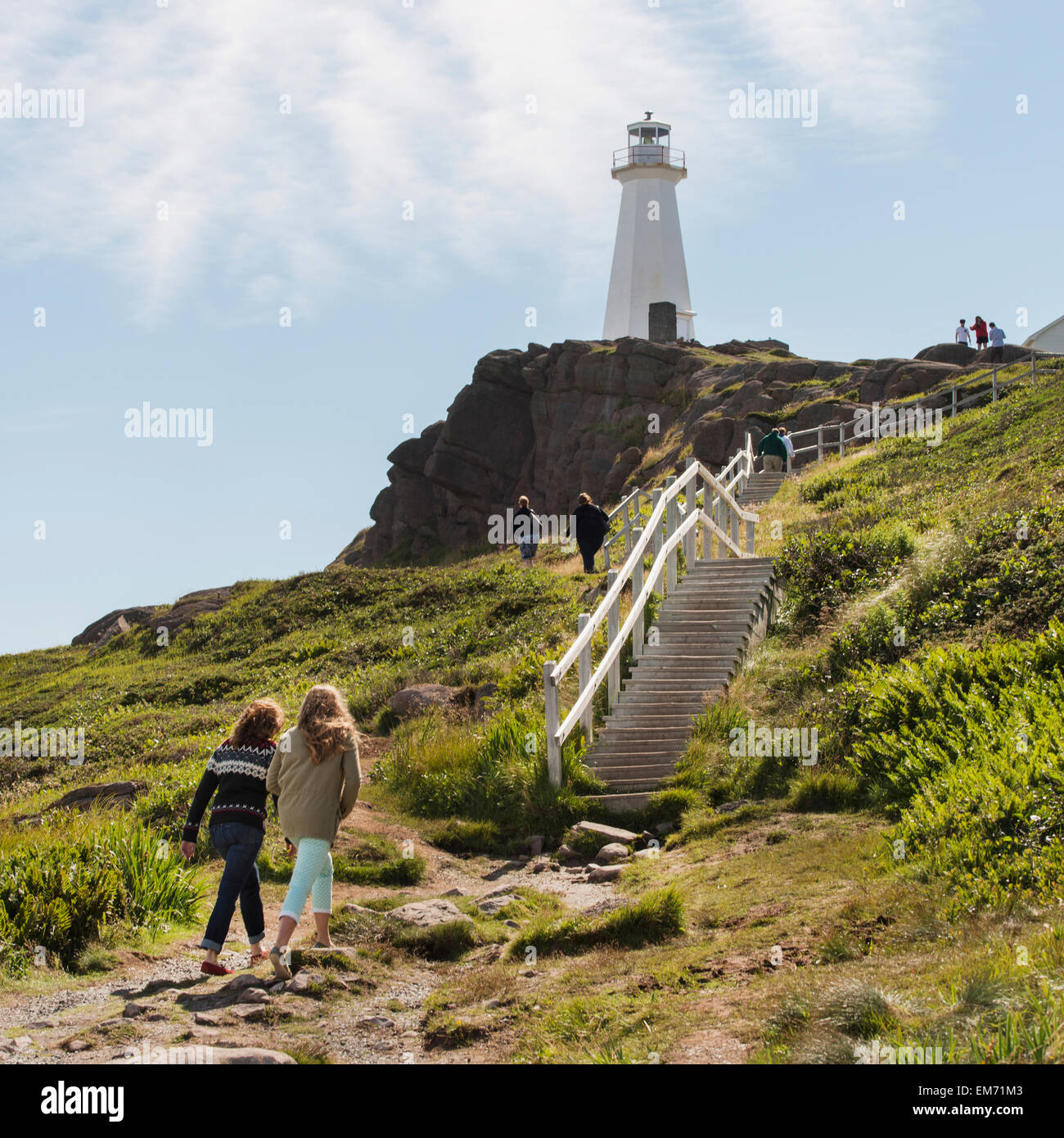 Tourists walking to steps leading up to a lighthouse on Cape Spear; St. John's, Newfoundland and Labrador, Canada - Stock Image