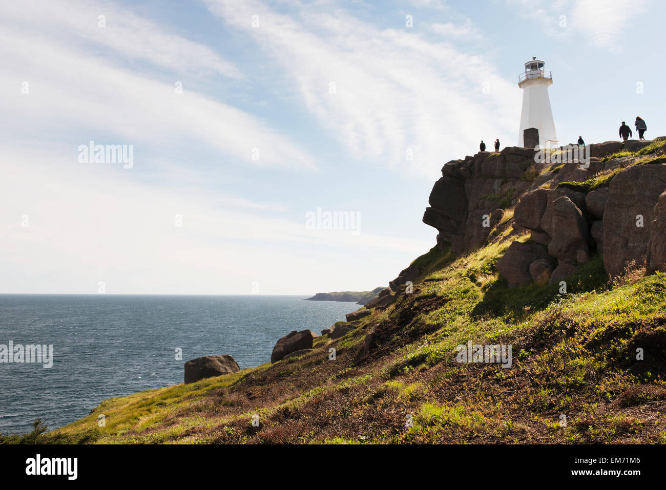 Tourists at a lighthouse on Cape Spear; St. John's, Newfoundland and Labrador, Canada - Stock Image