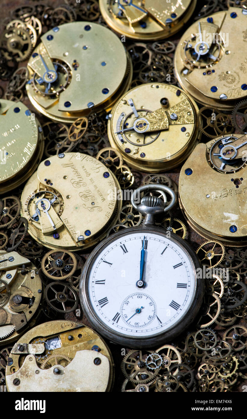 Old pocket watches, movements and cogs - Stock Image