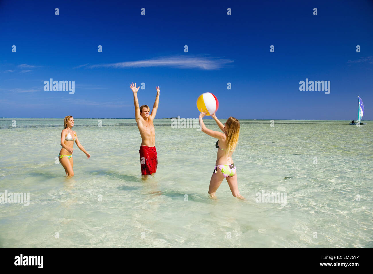 Hawaii Oahu Kaneohe Young People Playing With Beach Ball In Crystal Clear Water At The Sandbar Or Dissapearing Island