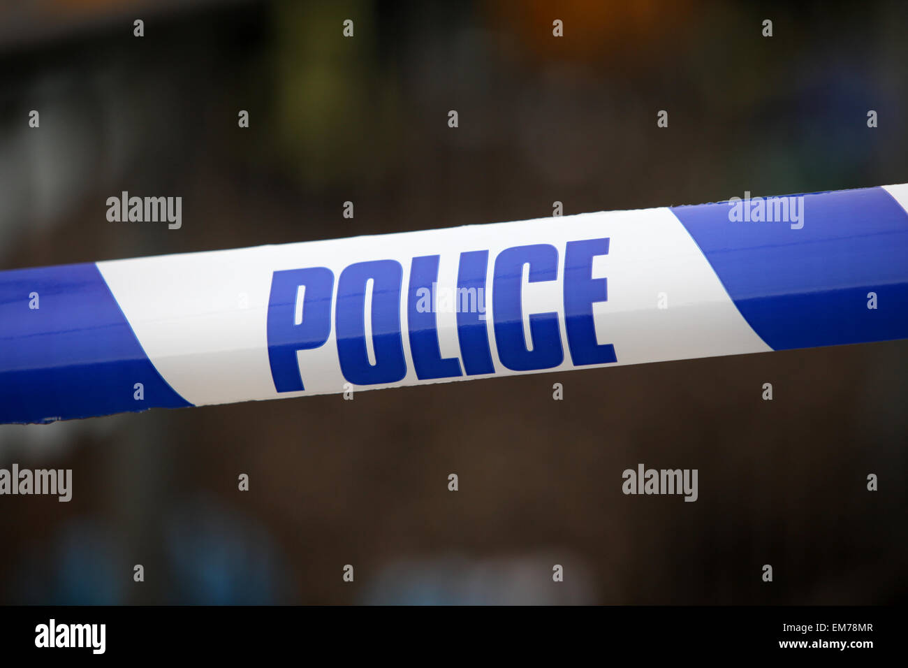 Police tape at the scene of a crime accident UK - Stock Image