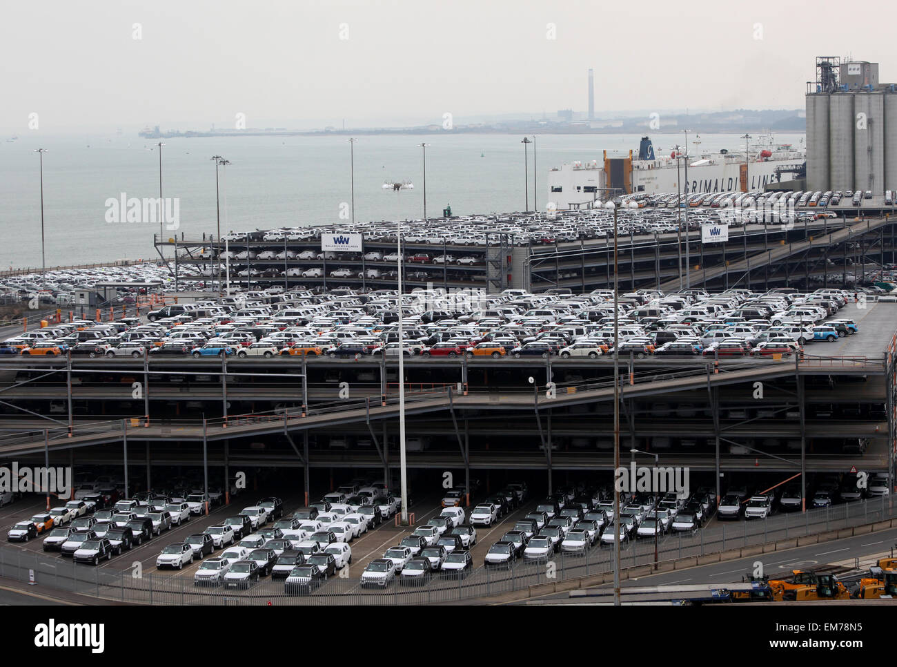 Southampton Docks Mini and Land Rover cars parked at Wallenius Wilhelmsen logistics awaiting export via a car transporter - Stock Image