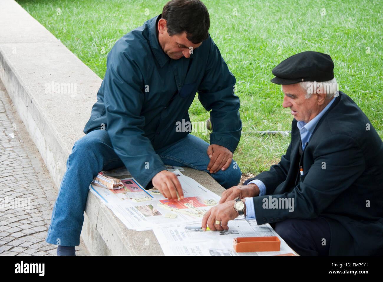 Men Playing Domino, Tirana, Albania - Stock Image