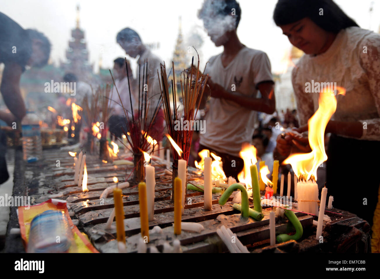 Yangon, Myanmar  17th Apr, 2015  People light candles and
