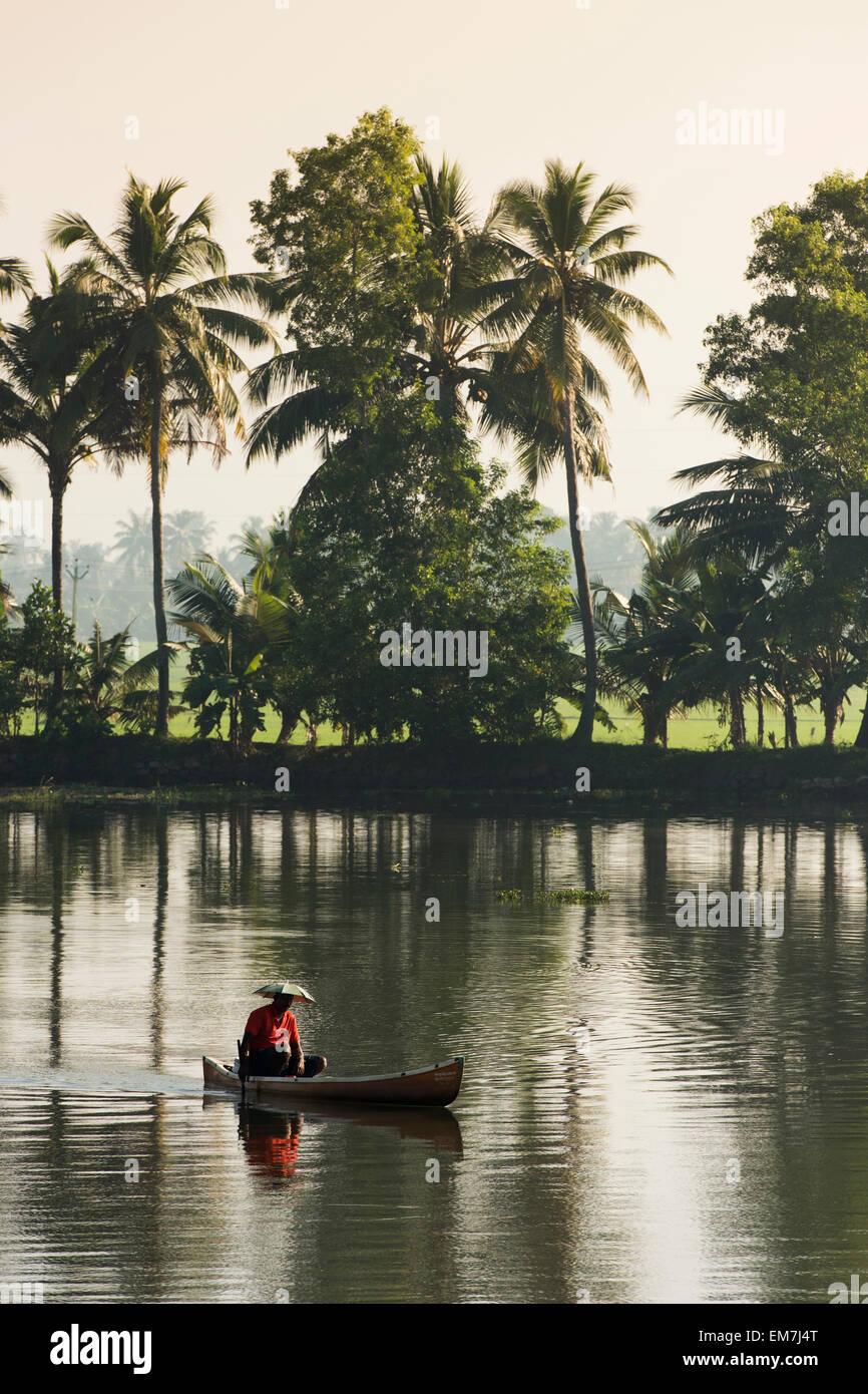 Fisherman in a small wooden boat, backwaters, Kerala, Malabar Coast, South India, India Stock Photo