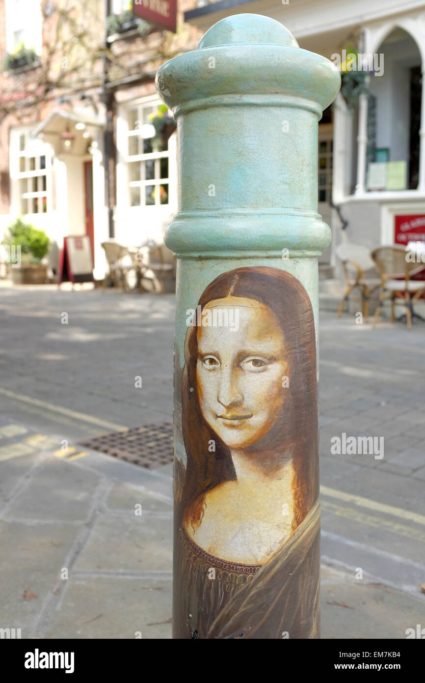 Mona Lisa painting on a bollard in Winchester - Stock Image