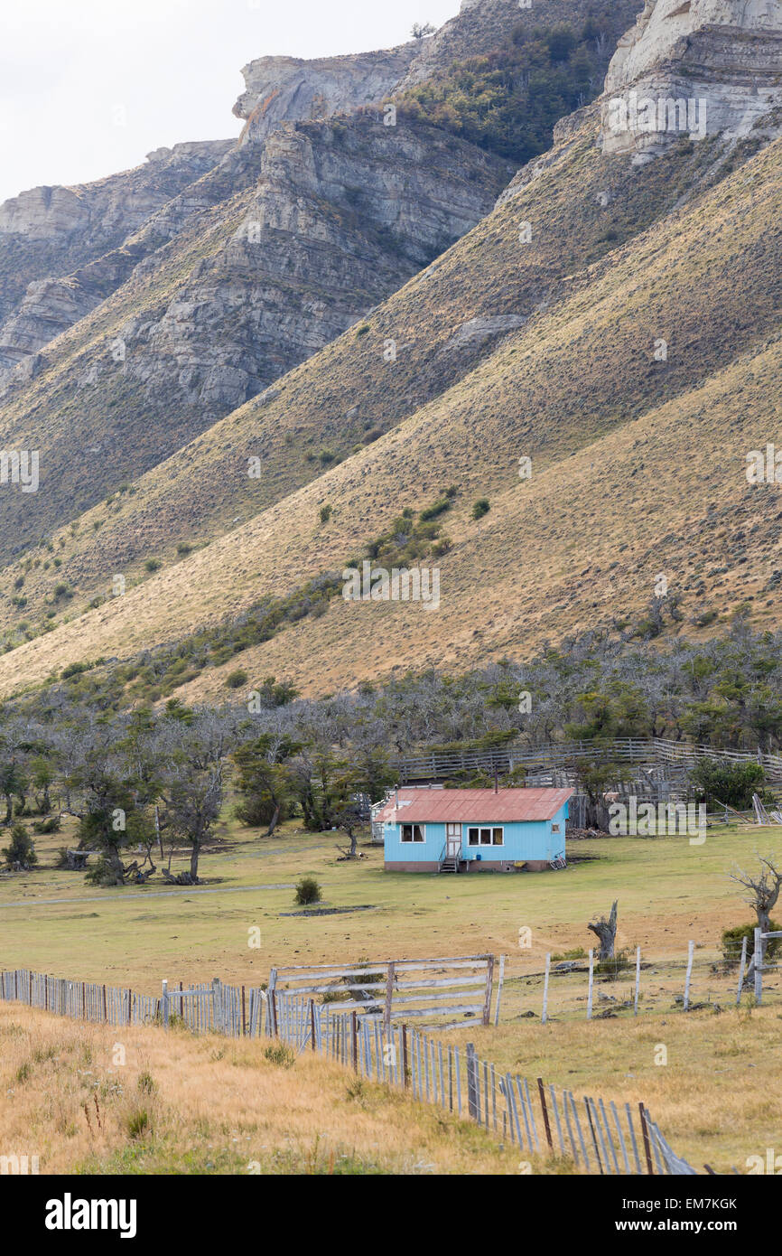 Small-holding and blue cabin, near Puerto Natales, Patagonia, Chile - Stock Image
