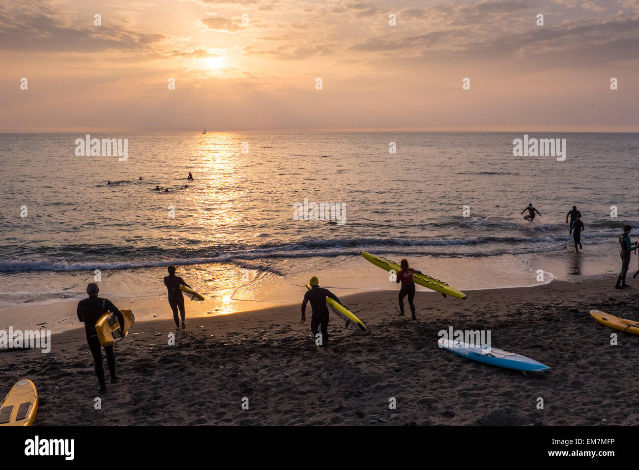 Aberystwyth, Wales, UK. 16 April 2015.  People undergoing training to qualify as RNLI lifeguards, on the beach at - Stock Image