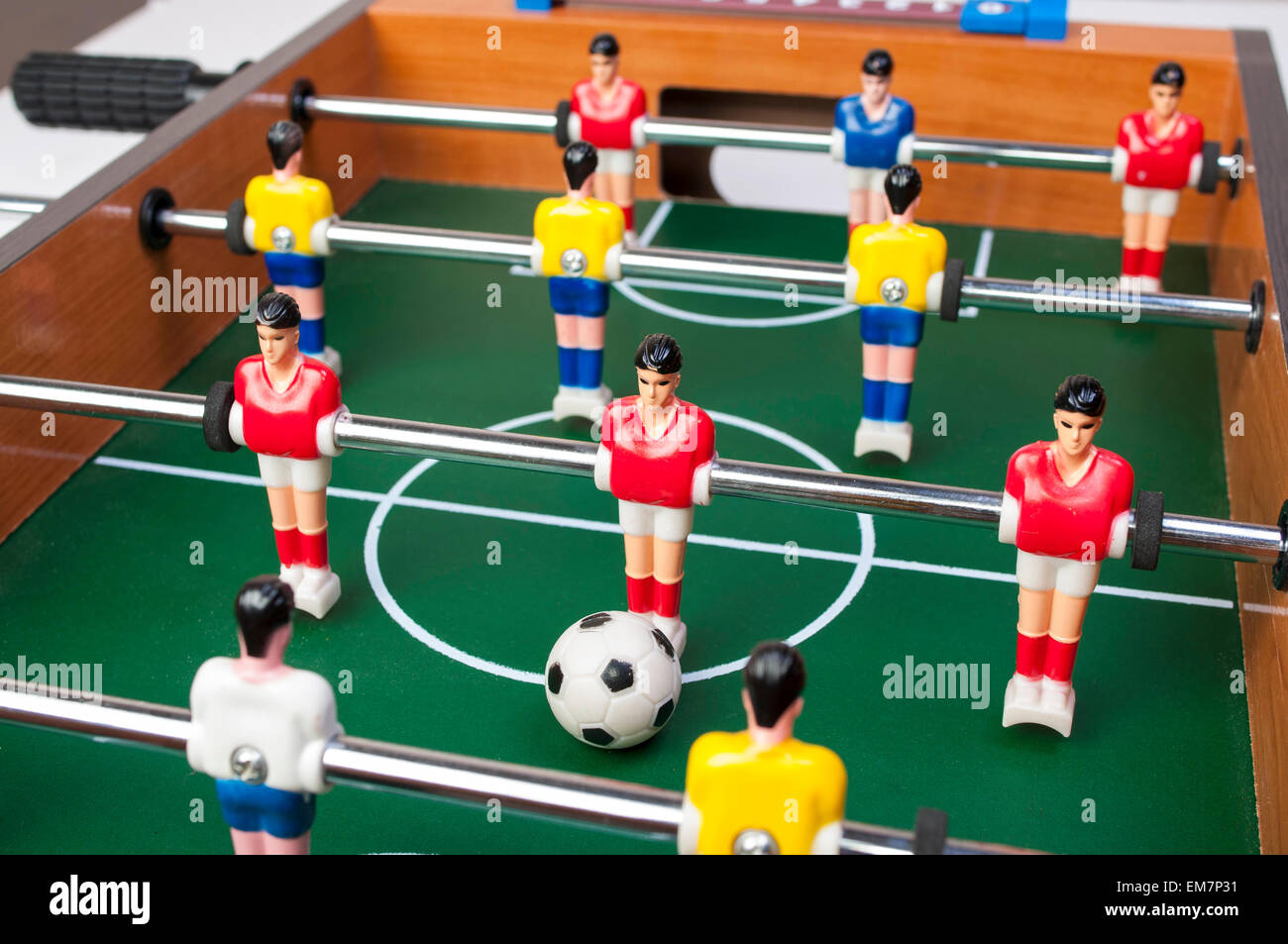 playing toy football players for everyone even in household conditions - Stock Image