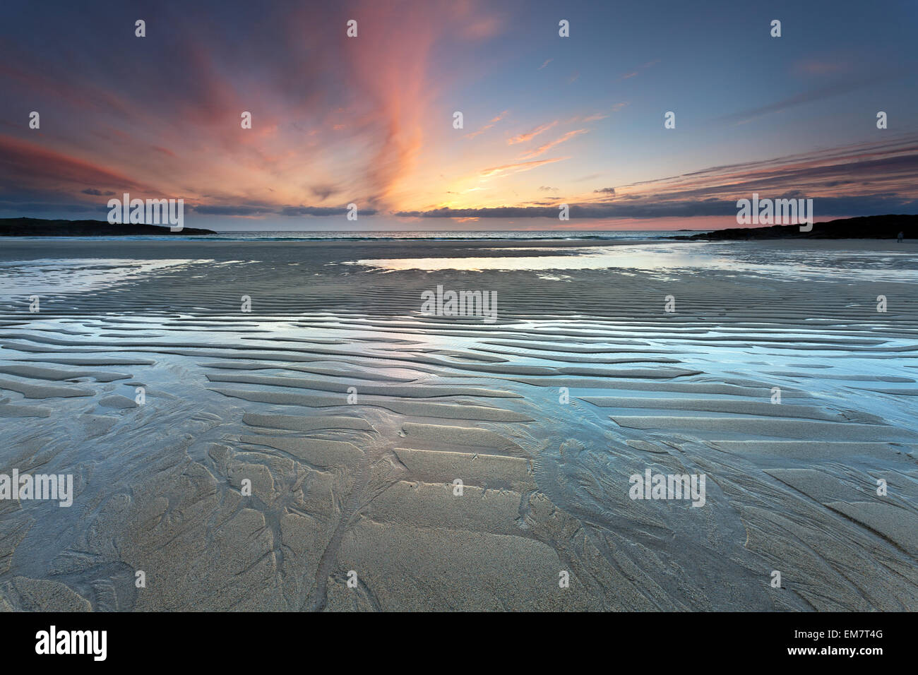 Tangasdale beach, Barra, Outer Hebrides of Scotland : rising tide at sunset - Stock Image
