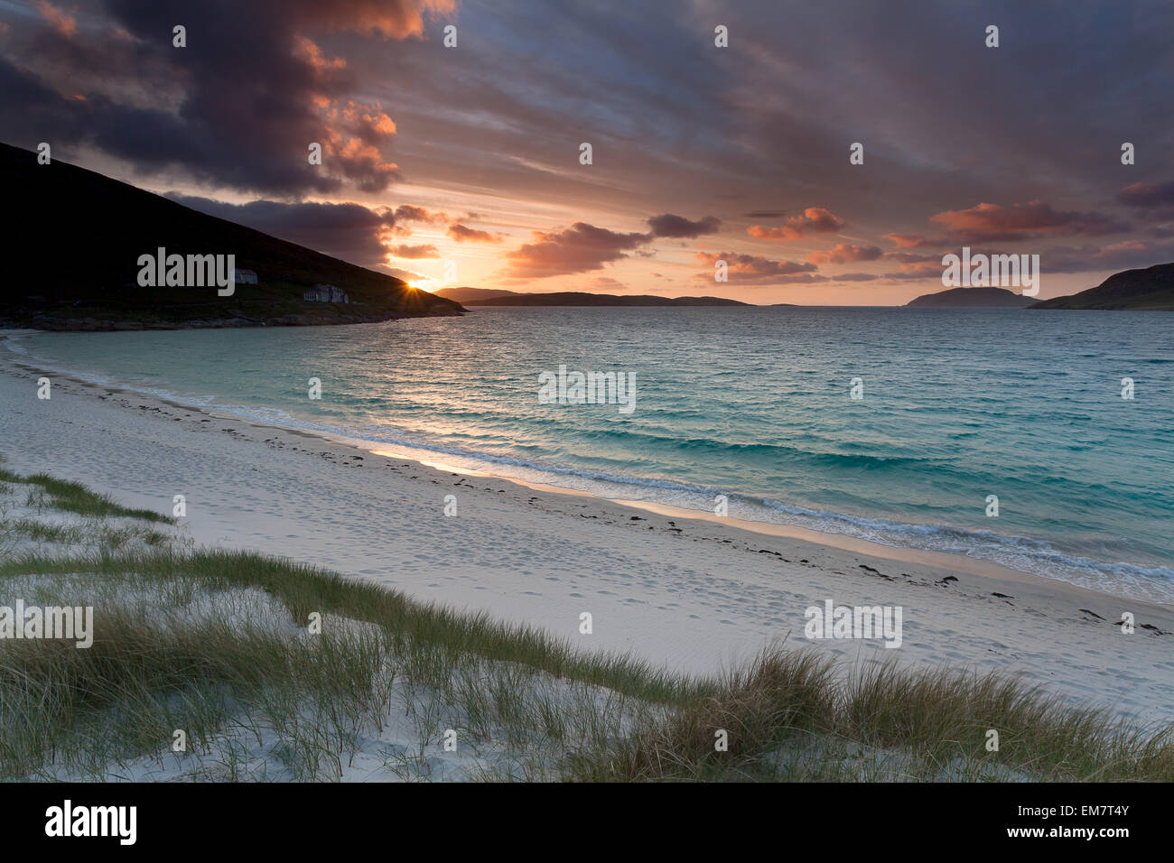 Sunrise on a scottish beach .  Isle of Vatersay, Outer Hebrides of Scotland . - Stock Image