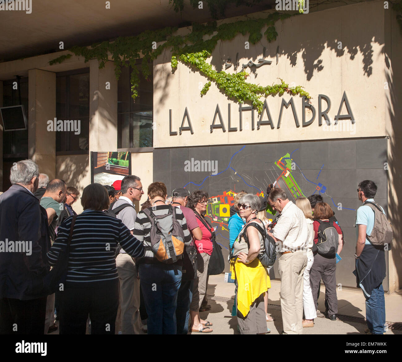 Groups of tourists wait in line at the entrance to the Alhambra, Granada, Spain - Stock Image