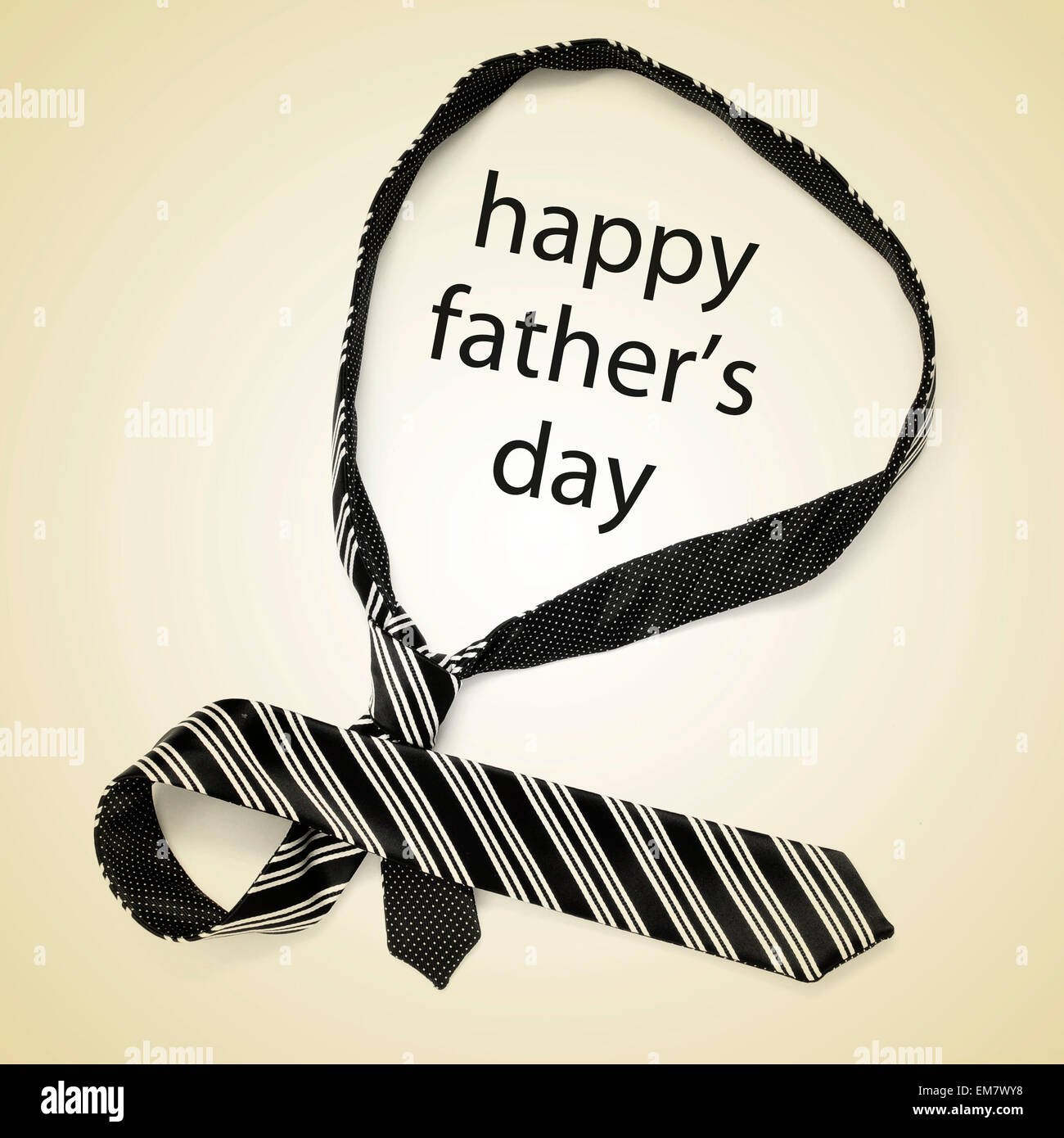 a necktie and the sentence happy fathers day on a beige background