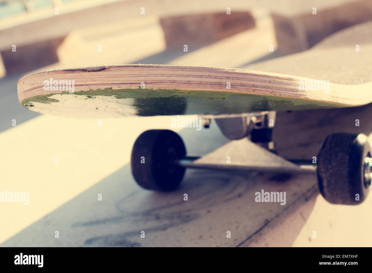 closeup of a skateboard in a skatepark - Stock Image