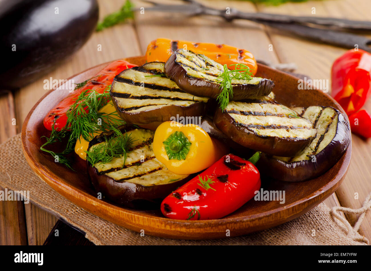 Grilled healthy vegetables  on  wooden  plate. Selective focus - Stock Image