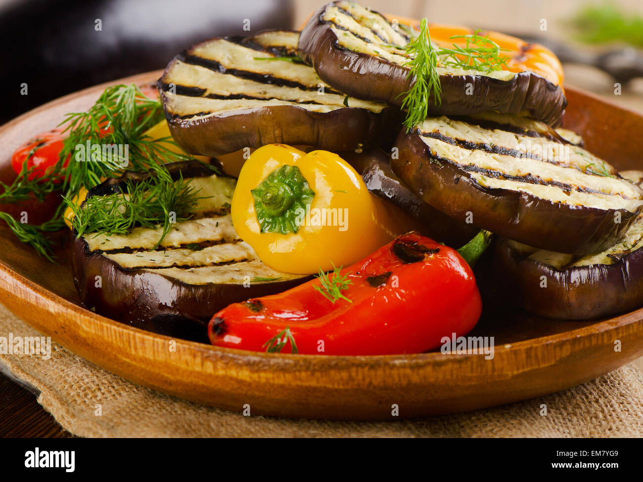 Grilled healthy vegetables  on a wooden  plate. Selective focus - Stock Image