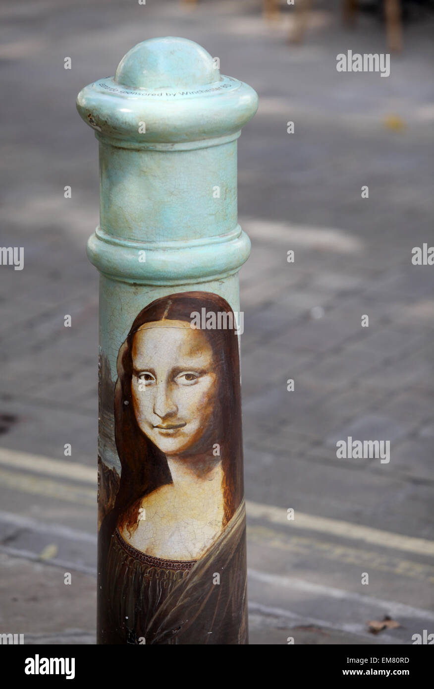 Mona Lisa painting on a bollard in The Square, Winchester funded by Winchester City Council - Stock Image
