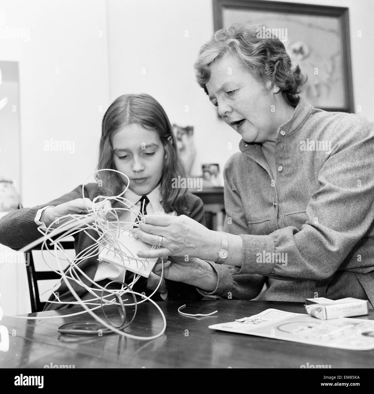 Author Jessica Mitford, basket weaving with the help of Amy Jenkins 30th November 1974. - Stock Image