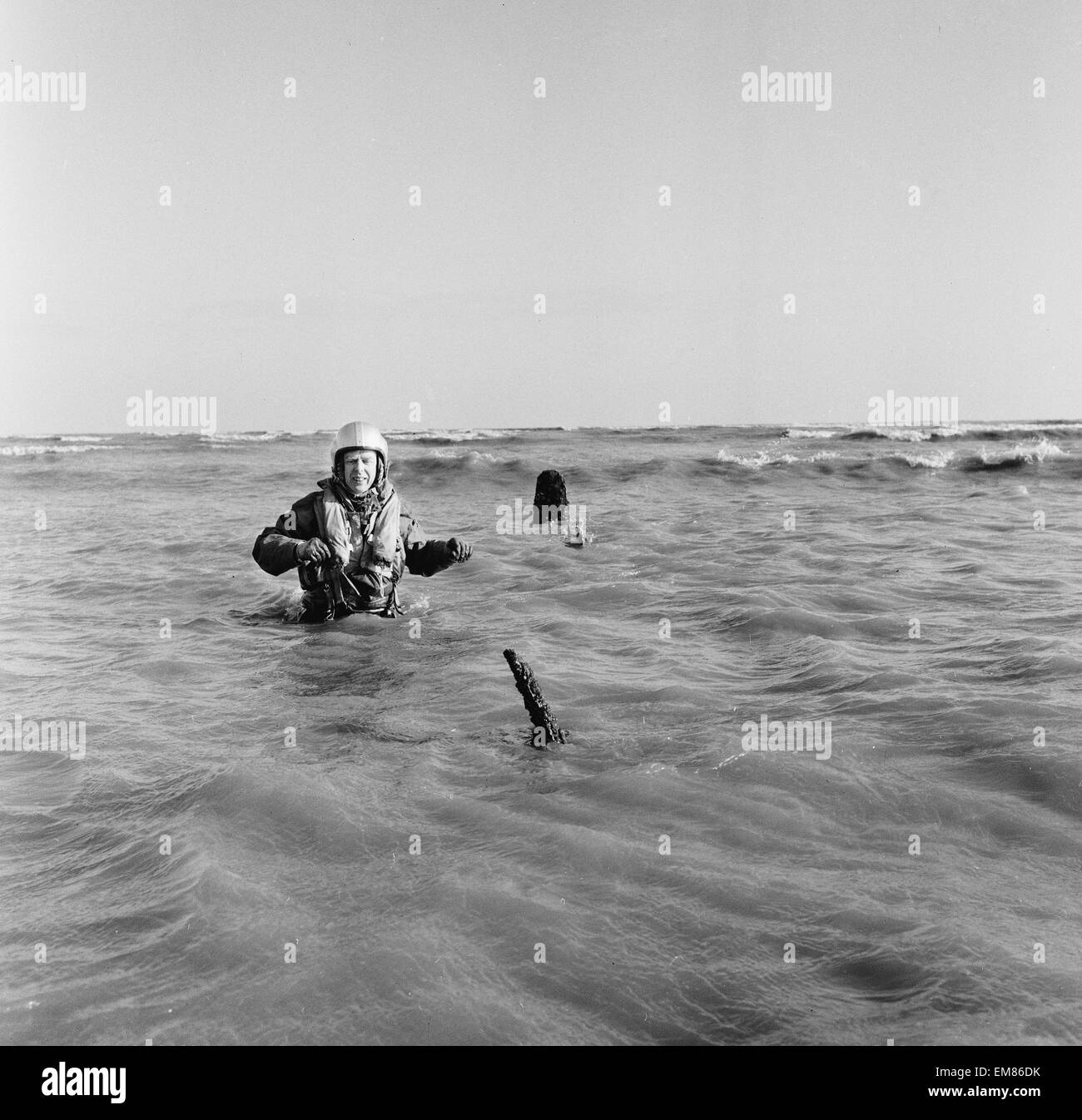 Master Navigator Colin Walsh of the RAF Air Sea Rescue service stands waist high in the water on a sandbank at Goodwin - Stock Image