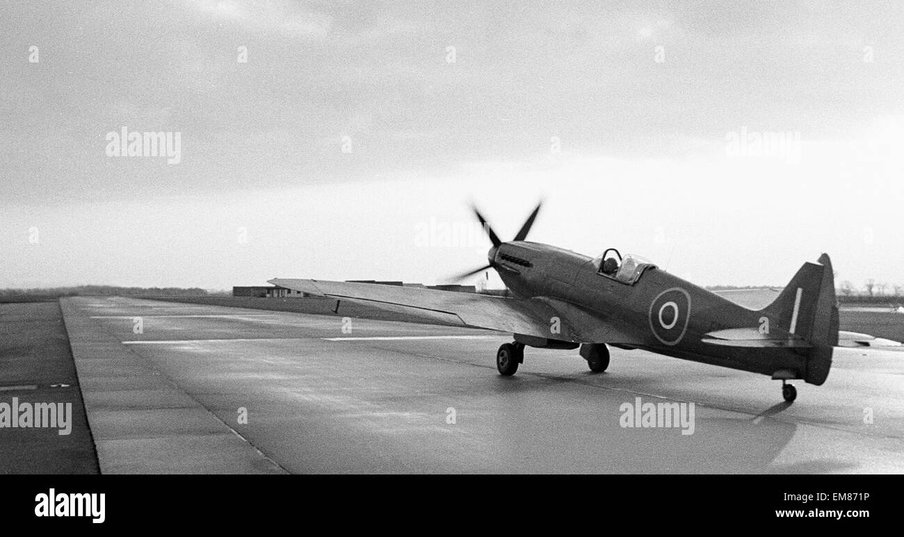 Spitfire PM631 a mk PRXIX aircraft seen here taxi-ing along the perimeter track at RAF Coltishall. The aircraft - Stock Image