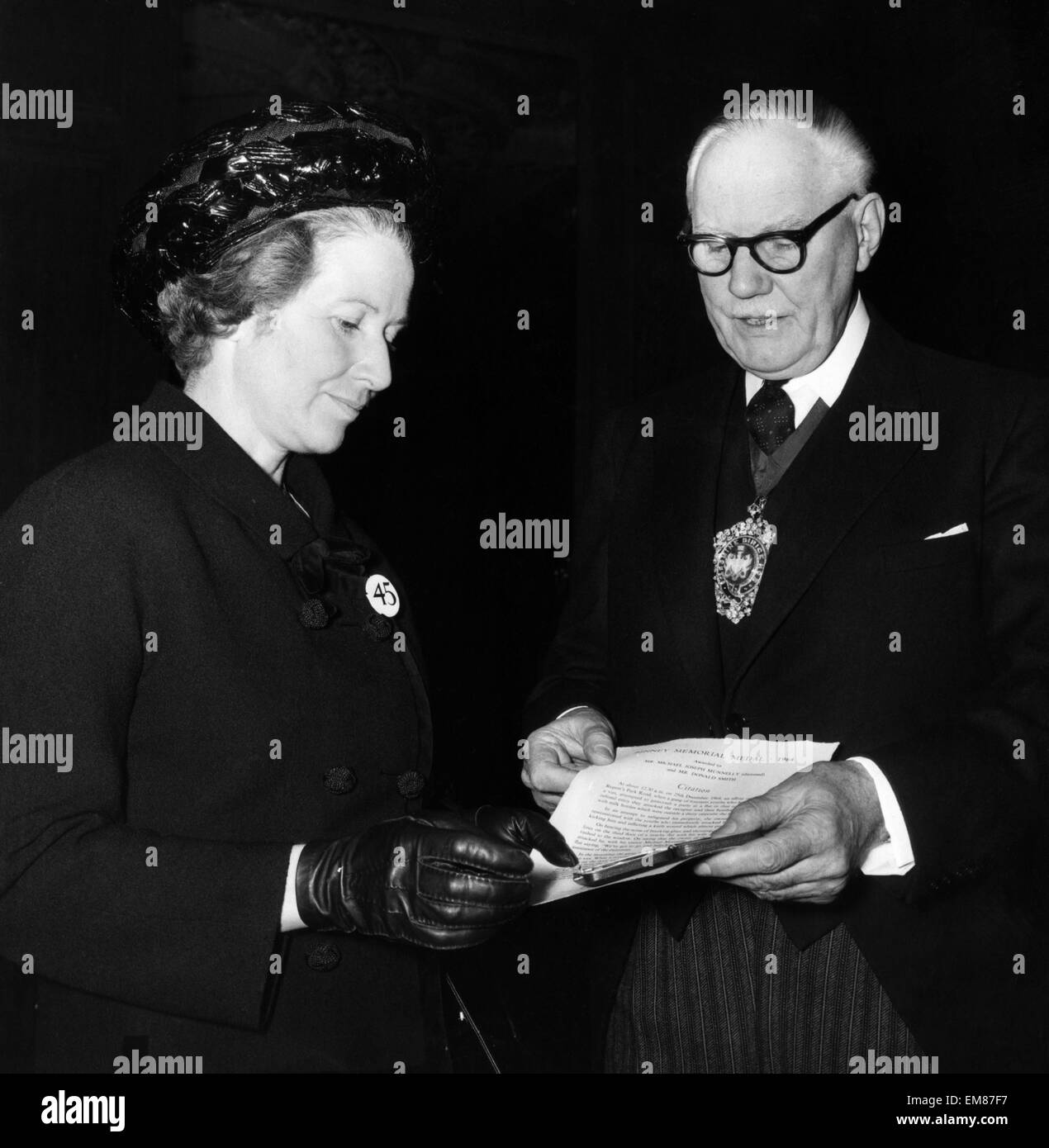 Proud mother Mrs Munnelly receives the first posthumous award of the Binney Medal at Goldsmith's Hall London 6th Stock Photo