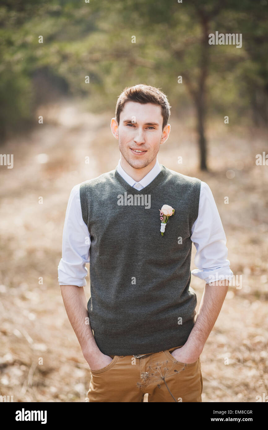 Man smiling. Portrait of handsome guy. Man with great smile against nature background. Happy groom. Groomsman. Portrait Stock Photo