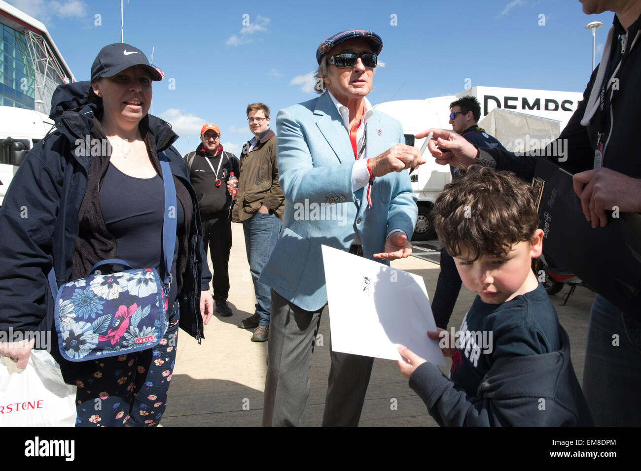 Sir Jackie Stewart, legendary former Formula One racing driver, signing autographs at Silverstone racing circuit, - Stock Image