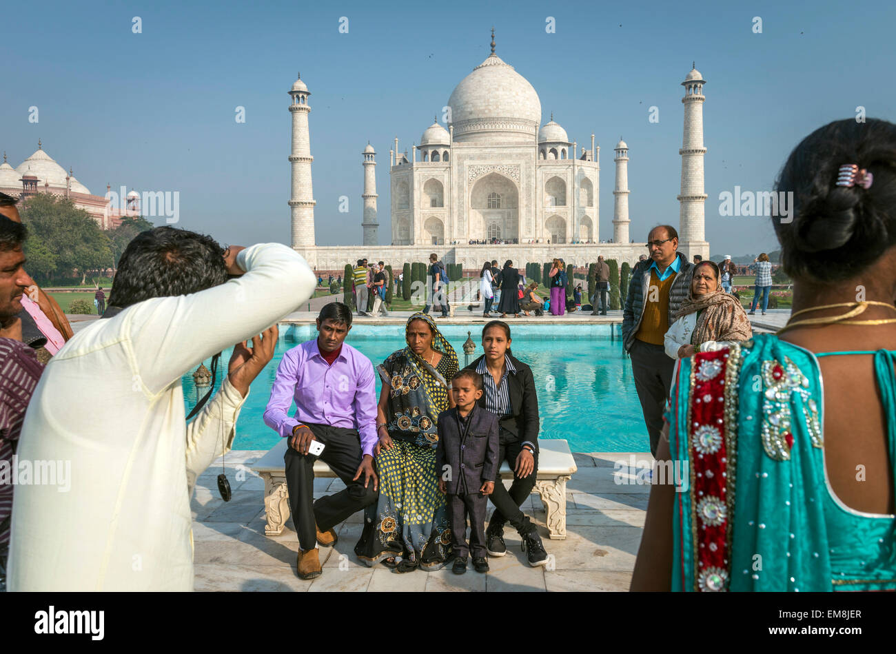 An Indian family being photographed in front of The Taj Mahal, Agra, India - Stock Image