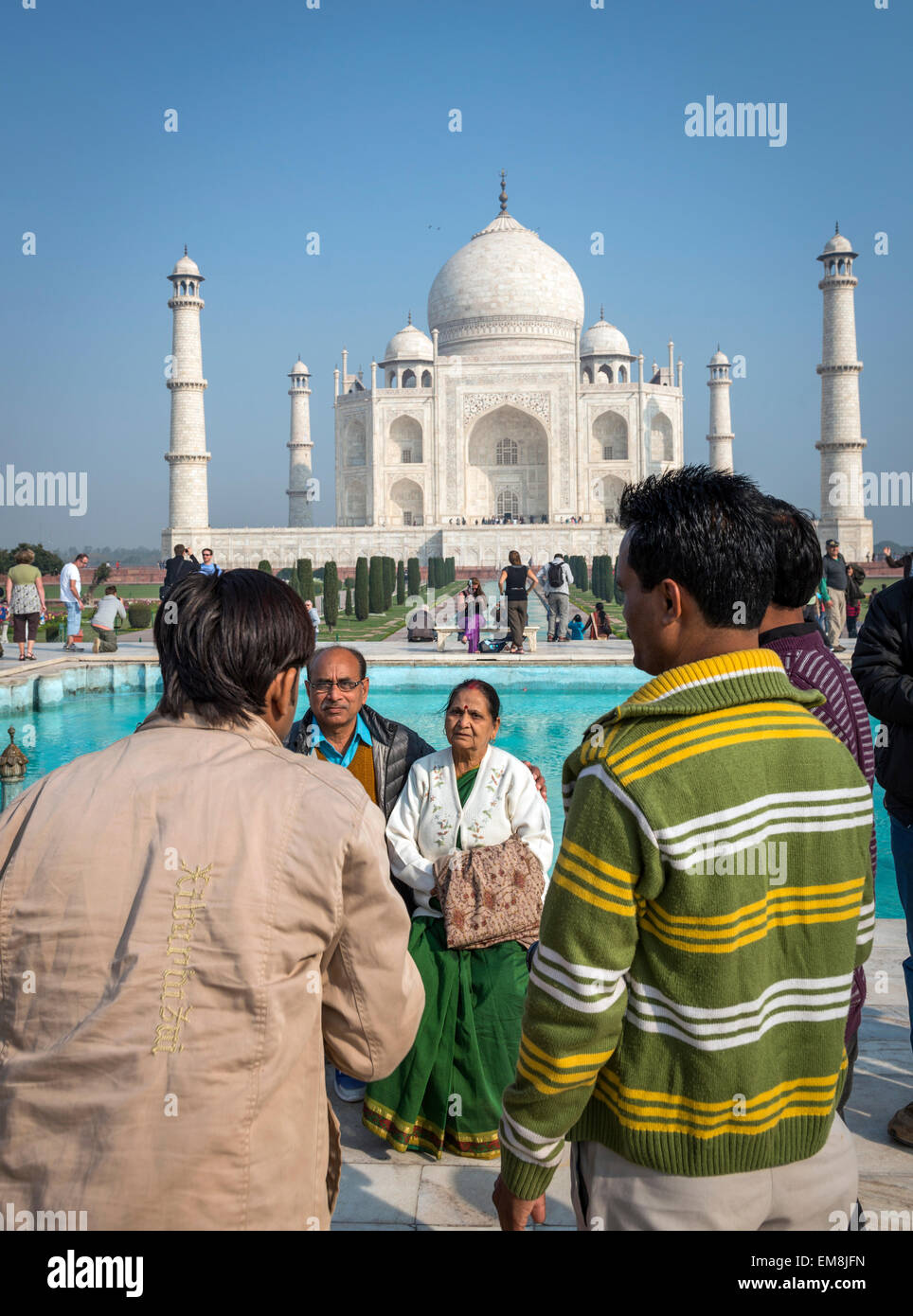 An elderly Indian couple being photographed in front of The Taj Mahal, Agra, India - Stock Image