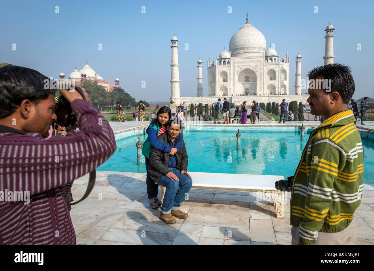 A young Indian couple being photographed in front of The Taj Mahal, Agra, India - Stock Image