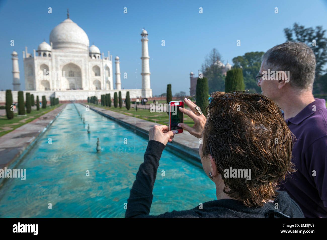 Tourists taking a snapshot on their smartphone of The Taj Mahal, Agra, India - Stock Image