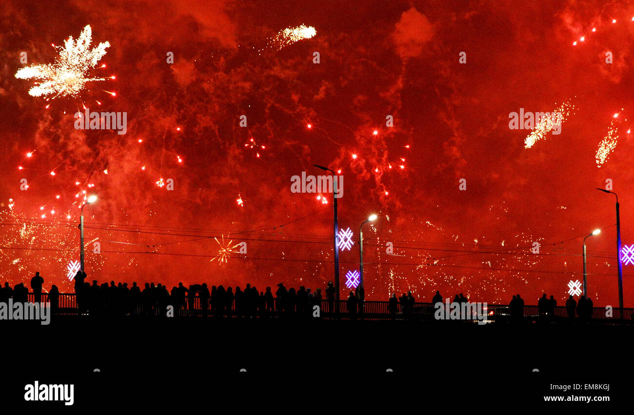 salute firework shooting in new year while people observing on bridge - Stock Image