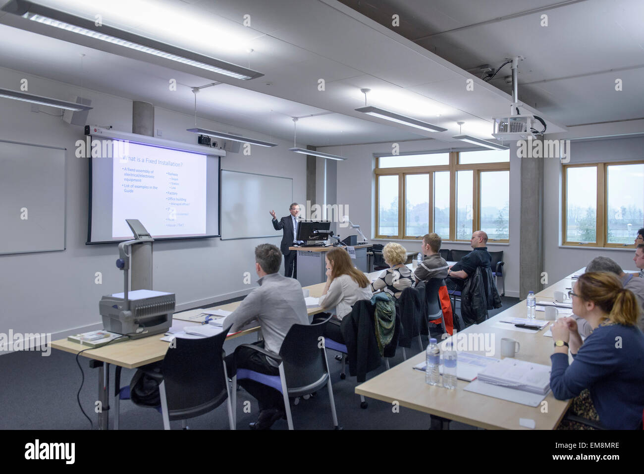 Lecturer addressing audience in seminar lecture - Stock Image